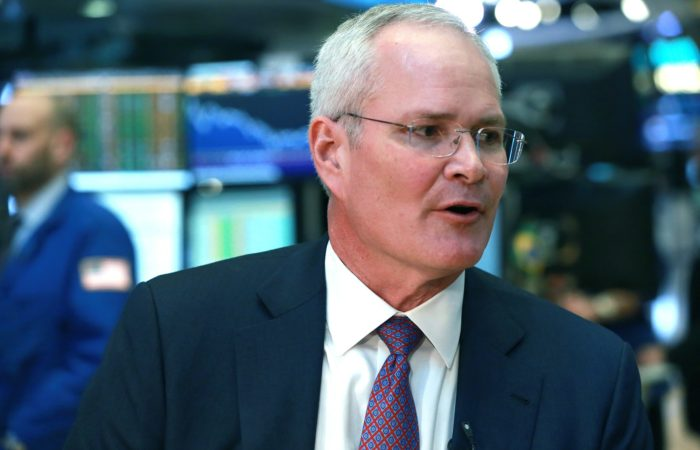 Exxon cuts capital spending by 30%, but CEO says it's 'committed to maintaining' dividend
